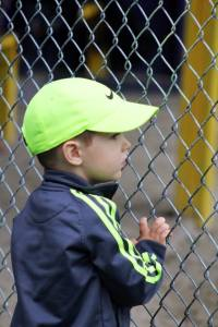 Watching big sis during her softball game